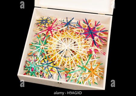Straw stars in wooden box. Handmade colorful Christmas decoration for windows, as gifts or to hang on the xmas tree. - Stock Photo