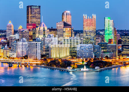 Pittsburgh, Pennsylvania downtown skyline at dusk. Located at the confluence of the Allegheny, Monongahela and Ohio - Stock Photo
