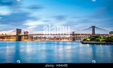 Brooklyn Bridge and Manhattan skyline at dusk on Pier2 park in New York City - Stock Photo
