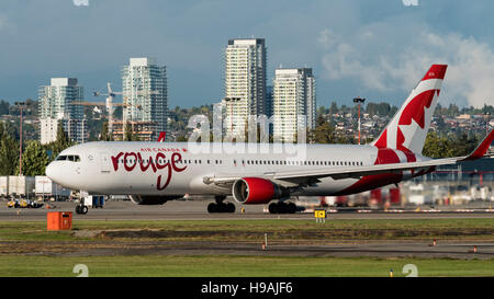 Air Canada Rouge Boeing 767-300ER C-FMLV wide-body airliner ready for take off Vancouver International Airport Canada - Stock Photo