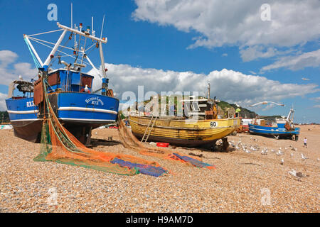 Hastings trawlers with colourful nets drying on the Old Town Stade Fishermen's beach, Rock-a-Nore, Hastings, East - Stock Photo