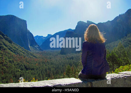 Woman watching Yosemite Valley from Tunnel View in Yosemite National Park. - Stock Photo