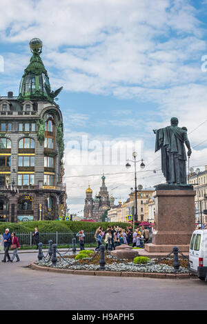 ST. PETERSBURG, RUSSIA - JULY 13, 2016: The monument to M. I. Kutuzov near Kazan Cathedral with building Singer - Stock Photo