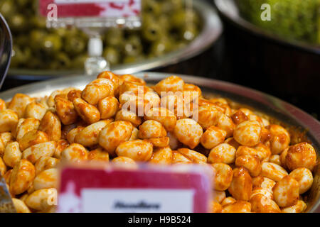 Fresh food produce in silver bowls with price signs at farmers Christmas market, deli - Stock Photo