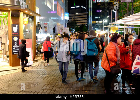 Street scene at night in Myeong-dong, Seoul, South Korea - Stock Photo