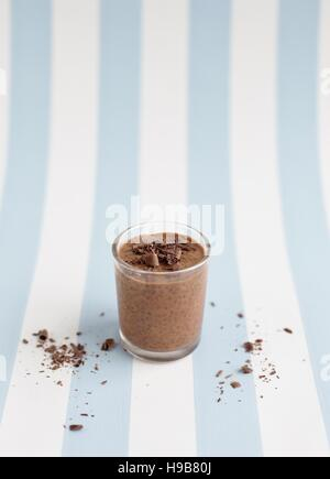 Chocolate chia seed pudding in a glass. - Stock Photo