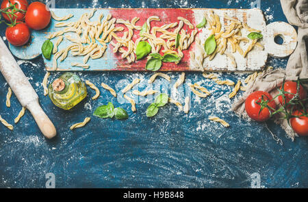 Ingredients for cooking Italian dinner on colofrul wooden board - Stock Photo