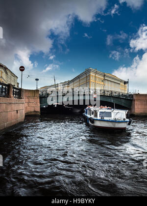 ST. PETERSBURG, RUSSIA - JULY 14, 2016: pleasure boat floats on the background of the bridge, St. Petersburg, Russia - Stock Photo
