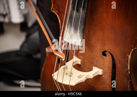 Close-up of double bass, wooden musical instrument - Stock Photo
