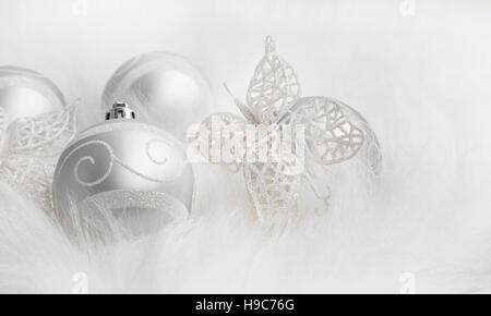 Christmas silver festive decorations in white fur - Stock Photo