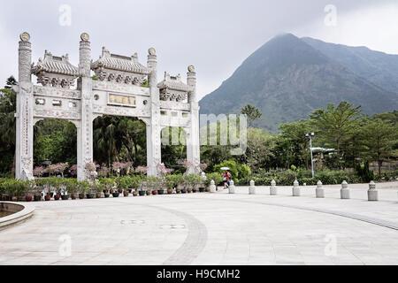 Entrance to Po Lin Monastery with mountain in background, Lantau Island, Hong Kong - Stock Photo