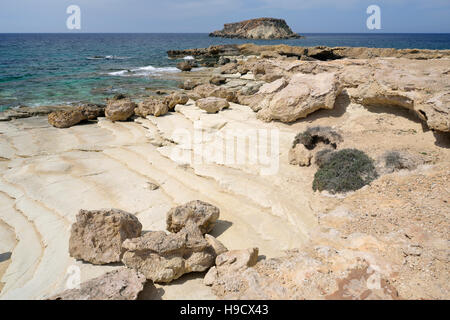 Chalk Beach at Cape Drepano, with Geronisos Island, Agios Georgios, Cyprus - Stock Photo