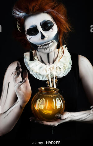 beautiful woman with make-up skull skeleton in helloween - Stock Photo