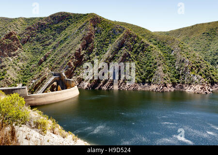 The Kouga Dam is an arch dam on the Kouga River about 21 km west of Patensie in Kouga Local Municipality, South - Stock Photo