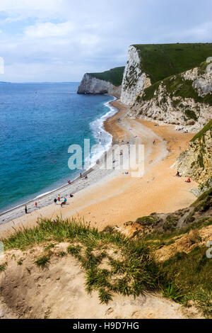 The view west from the clifftop at Durdle Door, Dorset, England, UK - Stock Photo