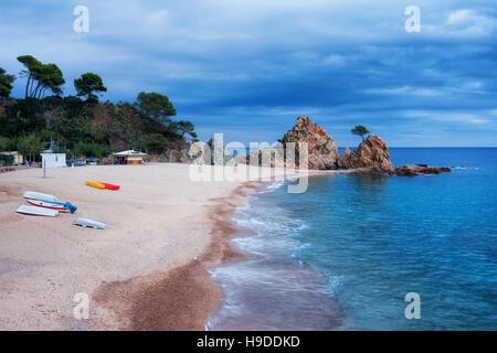 Spain, Costa Brava, town of Tossa de Mar, Platja de la Mar Menuda, beach at Mediterranean Sea - Stock Photo