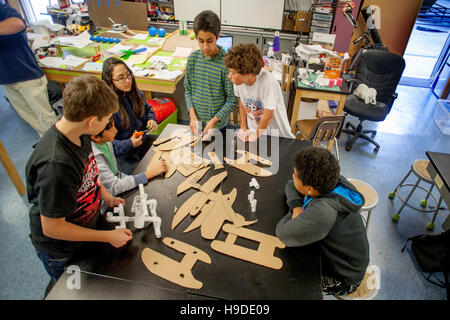Multiracial Mission Viejo, CA, middle school students organize templates to make a submersible vehicle in STEM (Science, - Stock Photo