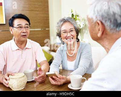 senior asian people having a pleasant conversation - Stock Photo
