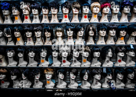 London, England - August 15, 2014: series of mannequins heads in a shop specializing in cosmetics - Stock Photo
