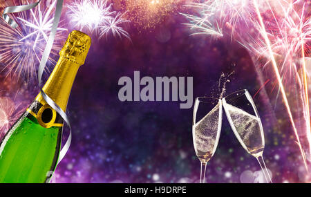 Bottle of champagne with glasses over fireworks background. Celebration concept, free space for text - Stock Photo