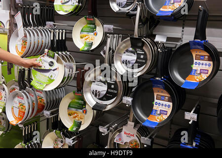 Frying pans in a Carrefour Hypermarket. - Stock Photo