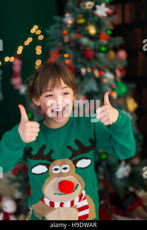 Portrait of Kid Girl Showing Thumbs Up - Stock Photo