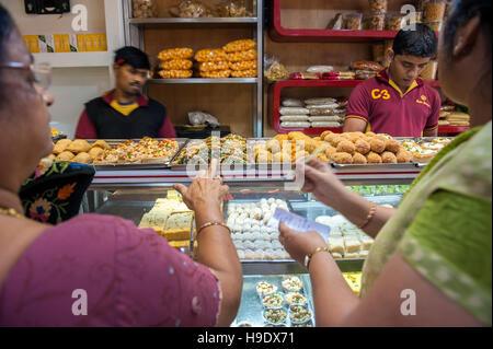 Buying sweets at Gupta Brothers in Kolkata. - Stock Photo