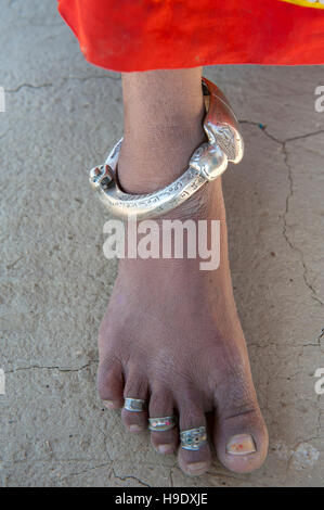 Traditional ankle bracelet on a young Meghawal girl in Hodka, a semi-arid region bordering the Great Raan of Kutch. - Stock Photo