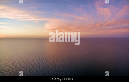 Aerial panoramic view of sunset over ocean. Nothing but sky, clouds and water. Beautiful serene scene - Stock Photo