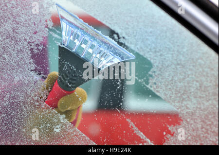 cleaning car windows from ice - Stock Photo