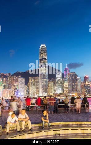 View of Hong Kong Island skyline from Tsim Sha Tsui promenade at dusk, Hong Kong, China - Stock Photo