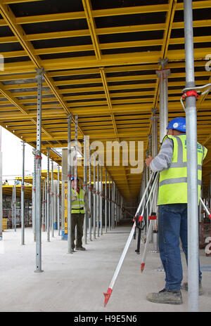 Worker Checking The Level Of The Concrete Floor Stock Photo