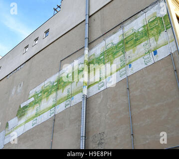 Graffiti by Italian artist Blu on a building in Berlin Kreuzberg district. - Stock Photo
