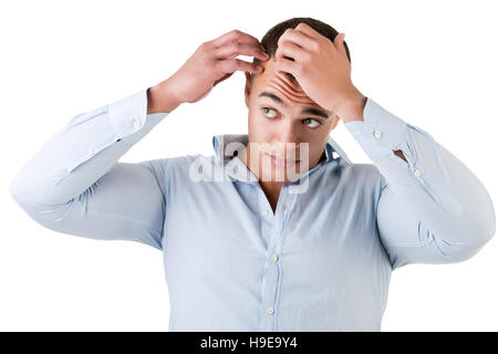 Man checking hairline, isolated in white - Stock Photo