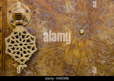 Brass Door and Door Knocker, Fez el Bali (The Medina), Fez, Morocco - Stock Photo