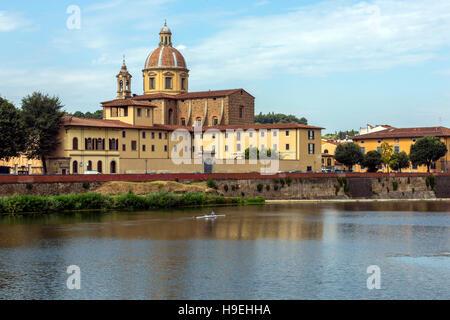 View over the River Arno towards the Basilica di Santo Spirito (Basilica of the Holy Spirit) in Florence, Italy. - Stock Photo