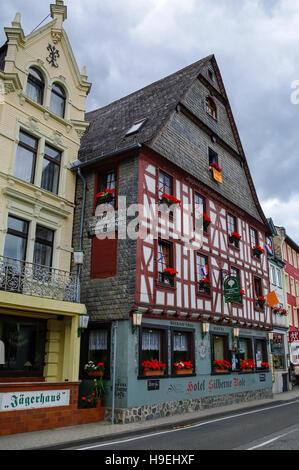 Sankt Goar, Germany - July 8, 2011: Houses on Rhine embankment in medieval village of Sankt Goar with Rheinfels - Stock Photo