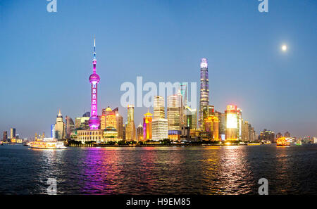 Night View of Shanghai New Skyline of Cityscape in the golden sunshine. The Tallest building is Shanghai Tower located - Stock Photo