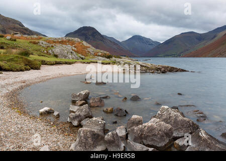 Rocky Beach on the Shore of Wast Water in Cumbria, UK. Water blurred by long exposure. - Stock Photo
