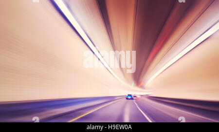 Vintage toned motion blurred car driving in tunnel, drunk driver vision concept. - Stock Photo