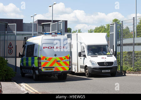 A G4S van and a Police Scotland van at Livingston Court - Stock Photo
