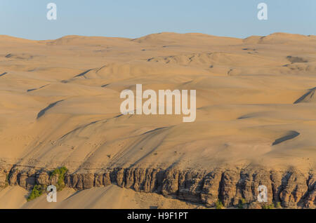 Impressive towering Namib Desert sand dunes of Angola and Namibia - Stock Photo