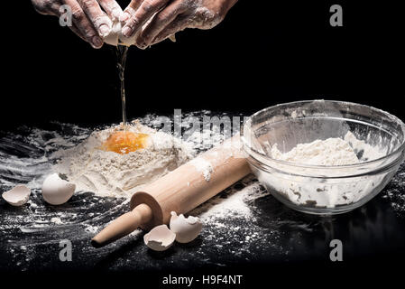 Close up of strong mans hands kneading the dough - Stock Photo