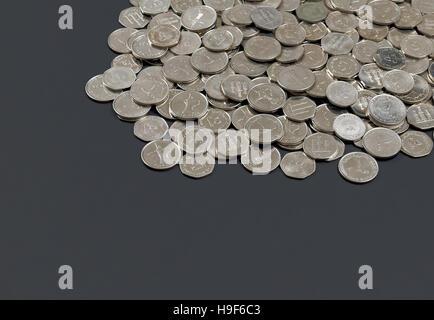 Pile of UAE dirham coins on dark background - Stock Photo