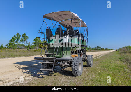 Swamp buggy for touring Big Cypress National Preserve in Florida, near Everglades National Park. - Stock Photo
