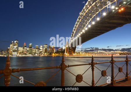 Sydney Harbour Bridge east side and Sydney Skyline, Australia during sunset. - Stock Photo