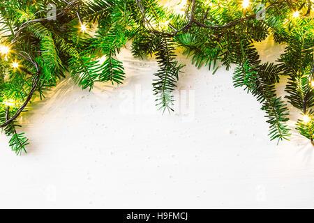 Fir tree and lights festive frame, Christmas holiday decoration - Stock Photo