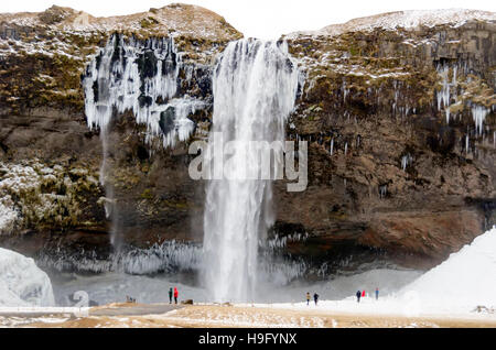 Seljalandsfoss Waterfall winter icicles Ring Road South Coast Iceland - Stock Photo