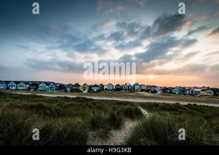 Hengistbury Head beach huts at sunset - Stock Photo