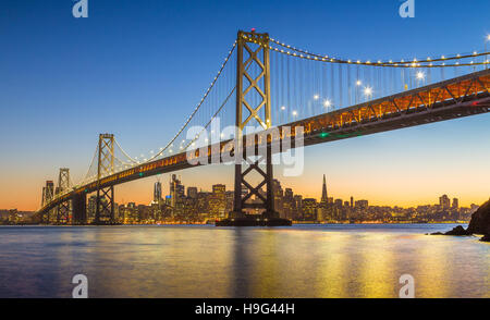 Classic panoramic view of San Francisco skyline with famous Oakland Bay Bridge in beautiful post-sunset twilight, - Stock Photo